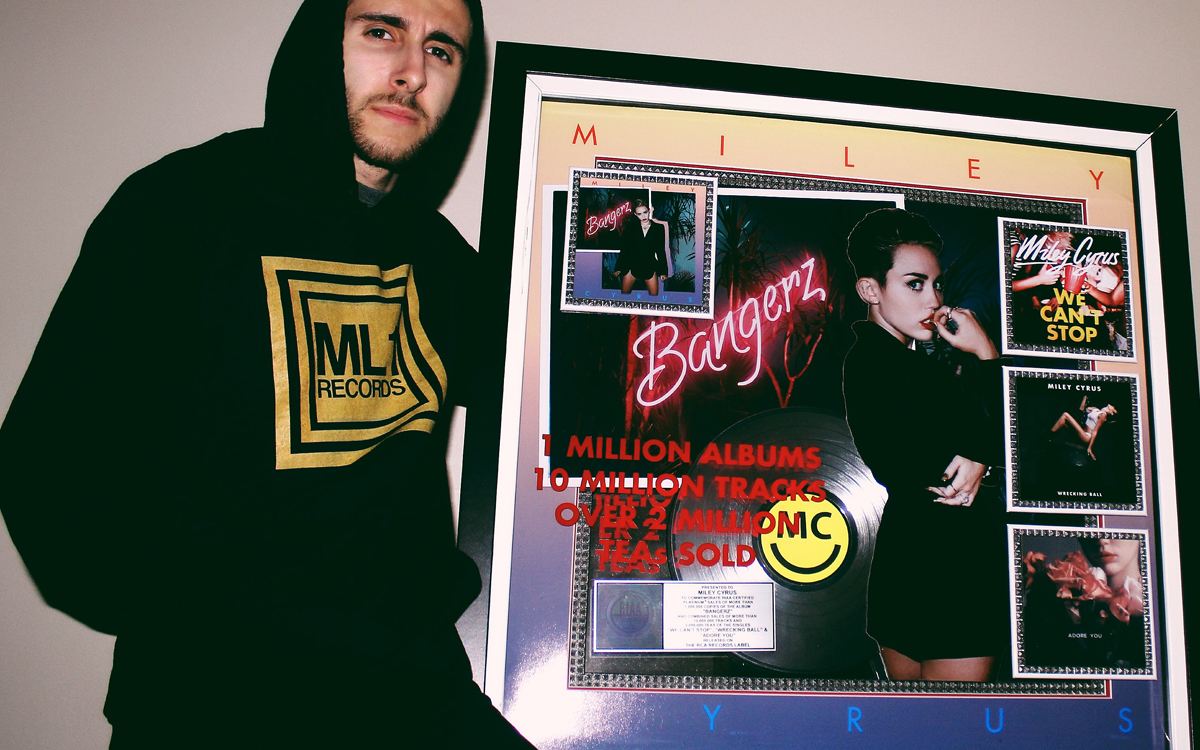 Joseph Karre with Miley Cyrus RIAA Platinum Plaque for Bangerz